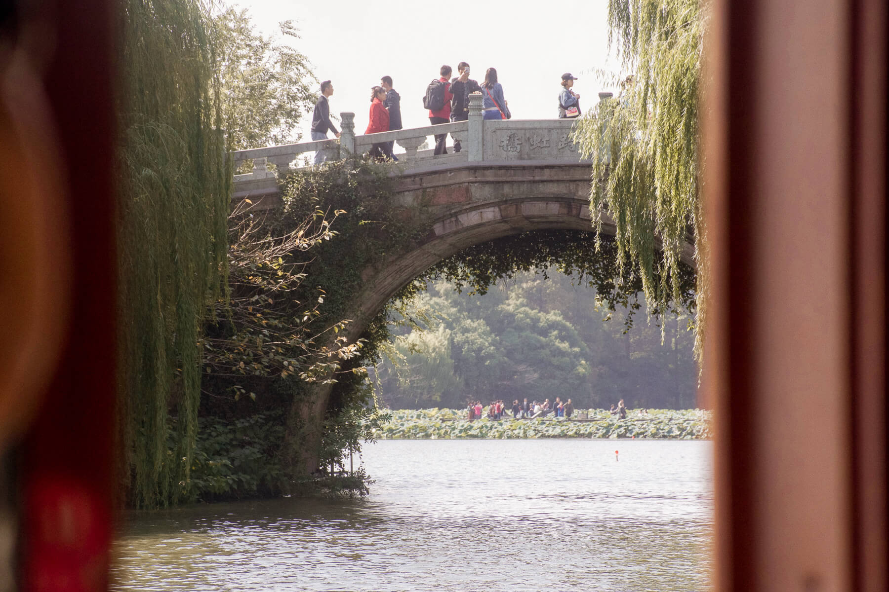 An arched bridge over the top of the West Lake in Hangzhou