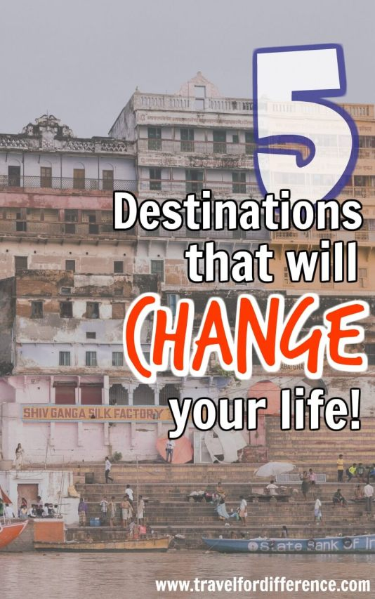 Banks of the Ganges River in Varanasi with text overlay - 5 Destinations that will change your life!