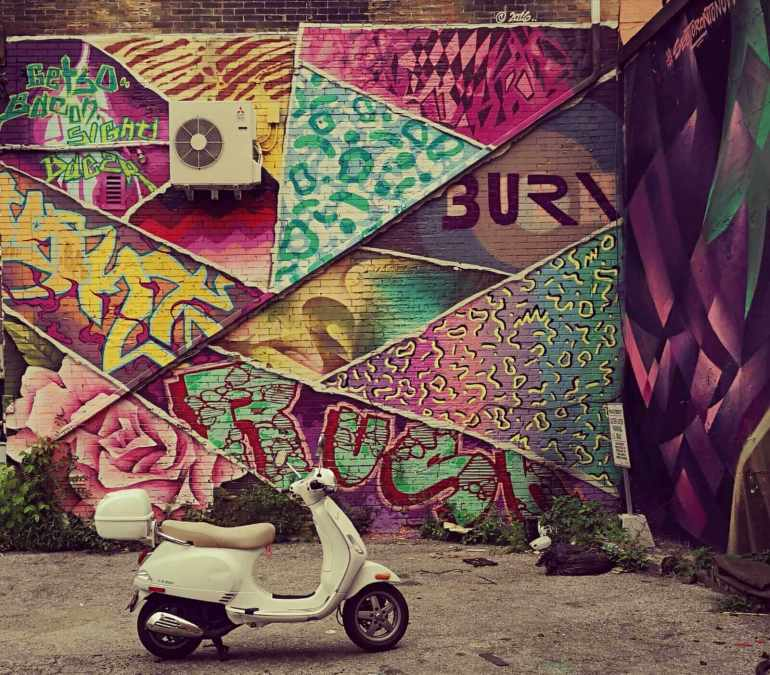 Scooter In The Parking Lot in Graffiti Alley