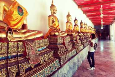 At Wat Pho, you'll see a line of Buddha Statues in one of the temples