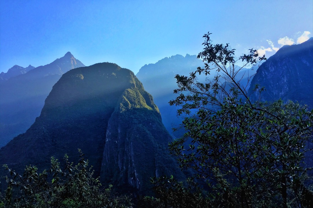 Climbing up to Machu Picchu during sunrise.