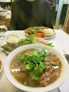 Bowl of pho, and chicken with rice at Pho Mui in Paris.
