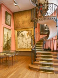 Musée Gustave Moreau spiral staircase and paintings.