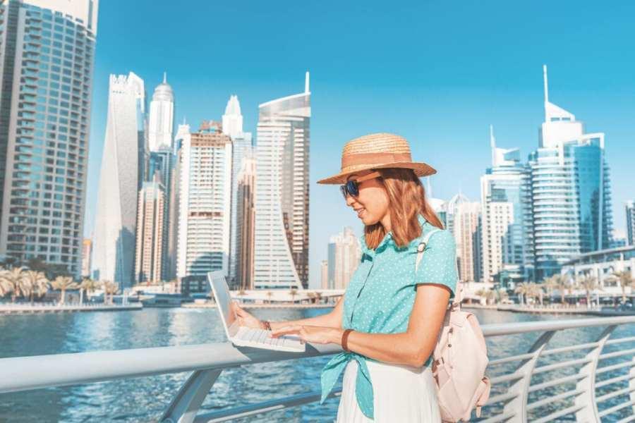 digital nomad working on laptop in Dubai marina
