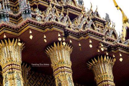 Capitals of Phra Mondop. The seven-tiered roof is supported by twenty glass-inlaid stucco pillars with lotus capitals.