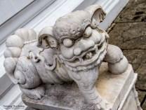 Mythical Chinese lion guarding Phra Sawet Kudakhan Wihan Yot.