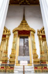 Ho Phra Monthian Tham. This building was built by the brother of Rama I after the first structure (built by Rama I) on this site burned down. The mother-of-pearl doors were scavenged from Wat Borom Buddharam in Ayutthaya. It houses sacred Buddhists texts and is never open to the public.