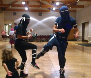 Sparing or dancing? I don't know but I do know smiling is going on under our ninja masks