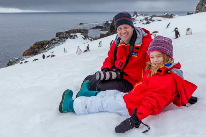 Eric and her daughter is watching penguins at Half Moon Island on their trip to Antarctica