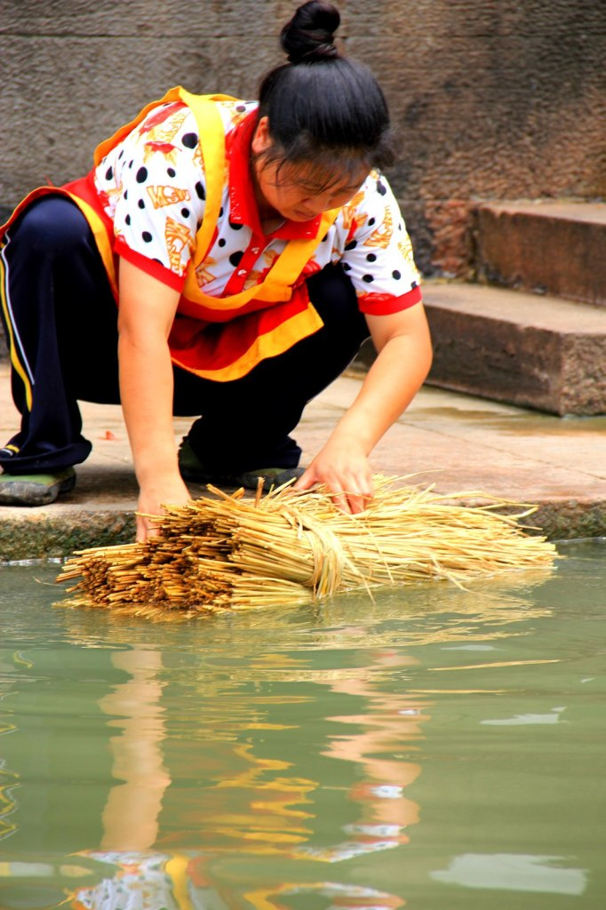 A Chinese lady washing her straws
