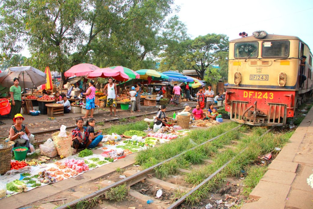 The fascinating local vendor next to the train