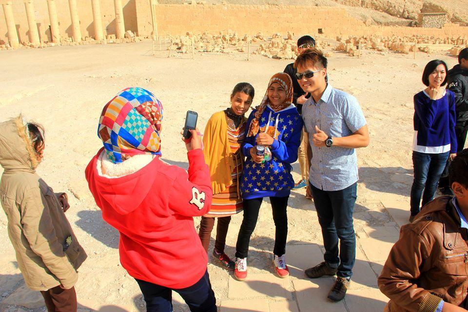 Teacher helping their pupils taking photos