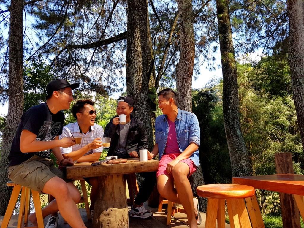 Men Gossiping Over Coffee