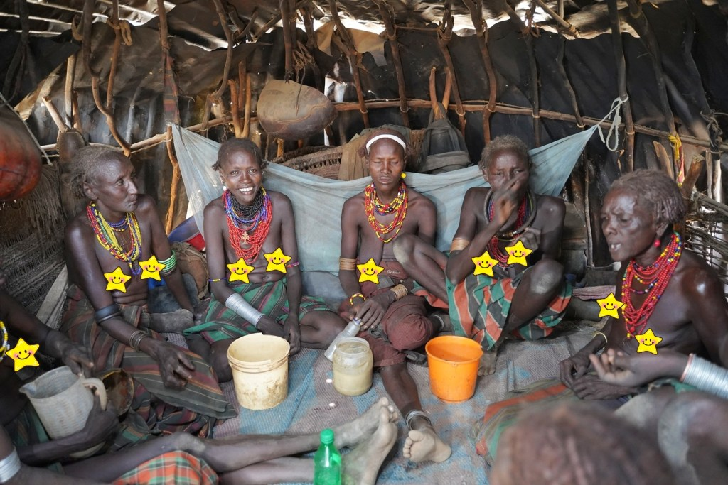 Dassanech women in their huts for celebrating a new born baby