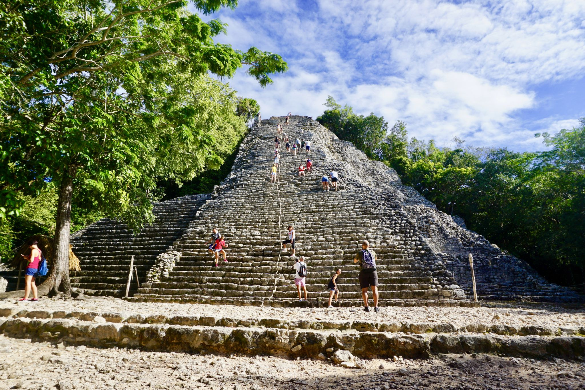 Climbing the Mayan pyramid Nohoch Mul in Coba