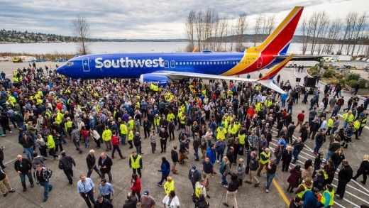 Boeing employees at the company's facility in Renton celebrate the 10,000th 737 to come off the production line.