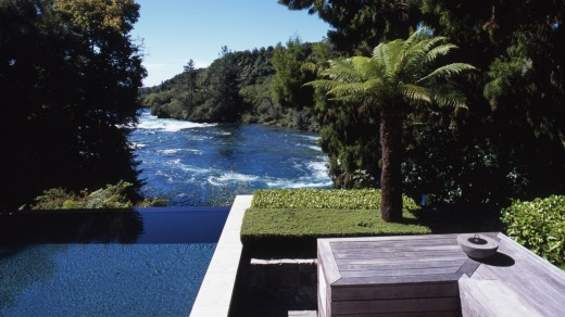 The Owner's Cottage infinity pool overlooks the Huka River.