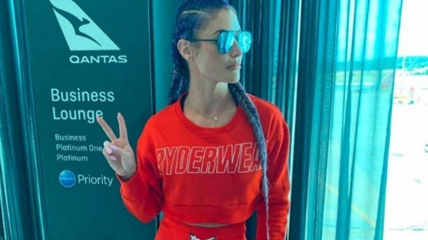 Former WWE wrestler Natalie Eva Marie refused entry to the Qantas business lounge for sportswear