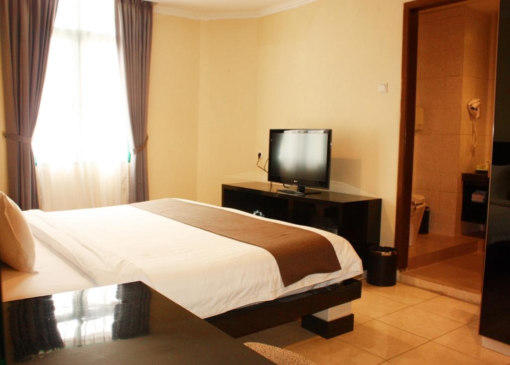 Three Bedroom Suite  Travellers Suites Medan