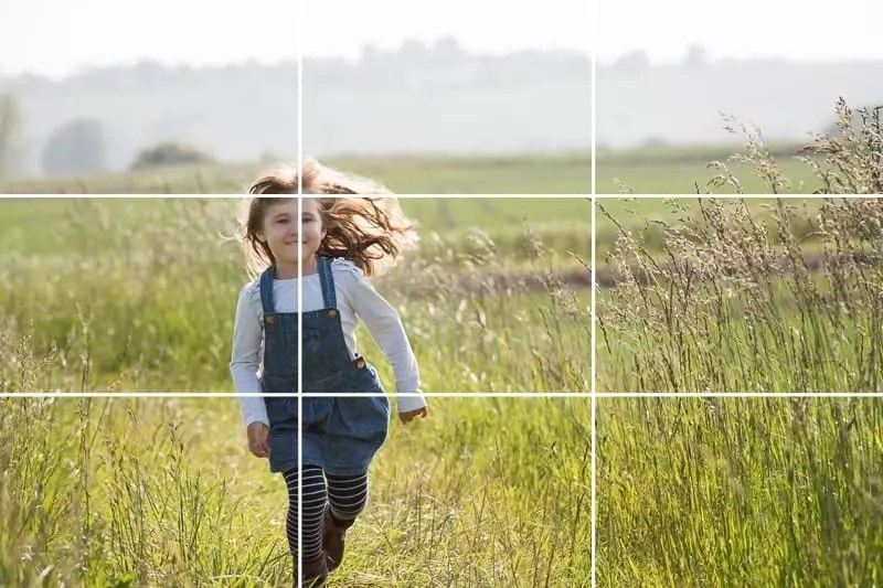 use the gridlines in your photos - picture of girl running in a meadow