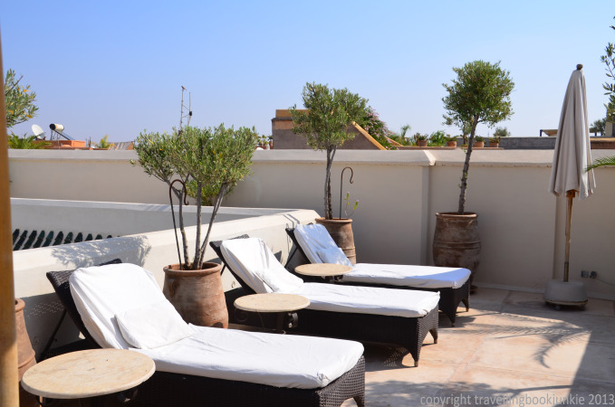 relaxing on sunloungers on the roof terrace of Riad camilia, Marrakech, Morocco