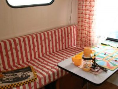 Retro caravan living area in red and white