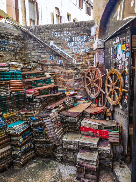 the book-steps of Libreria Acqua Alta in Venice are a highlight of anyone's visit. Climb up and from here you can see right over the wall to the canals below.