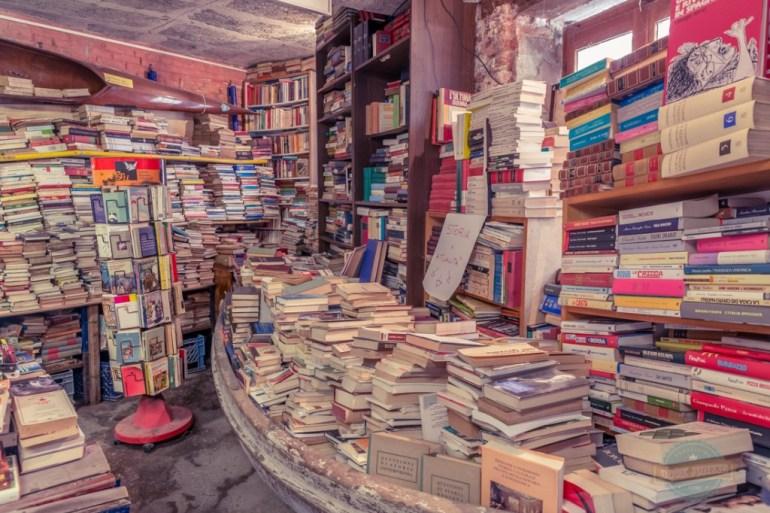 Stacks of books in Boat in Venice Italy