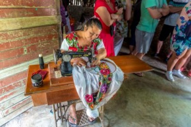 Creating garmets in the Coba Mayan Village, Mexico