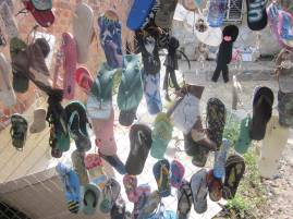 Flip flops, Jandals, Thongs on a fence