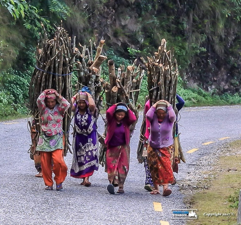 Ladies carrying wood