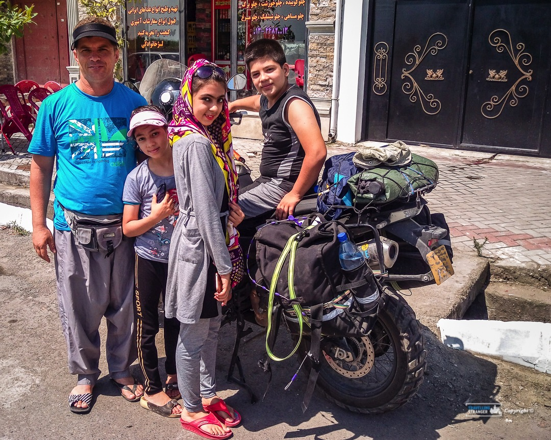 A young family welcomes me at my first road side stop in Iran.