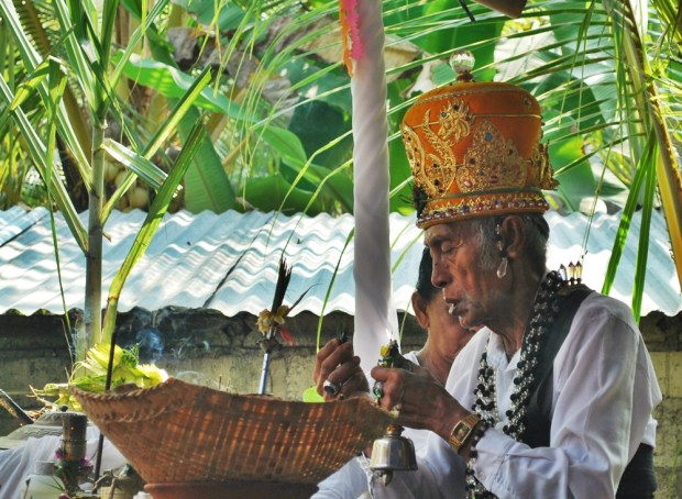 Watching a local ceremony take place in Balian Beach