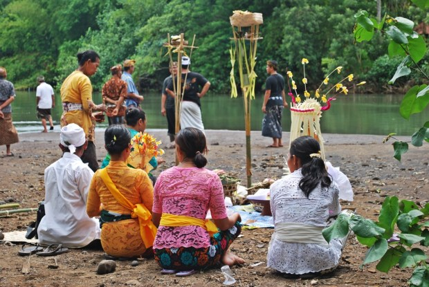 Witnessing the funeral of a local man on the banks of the River Balian