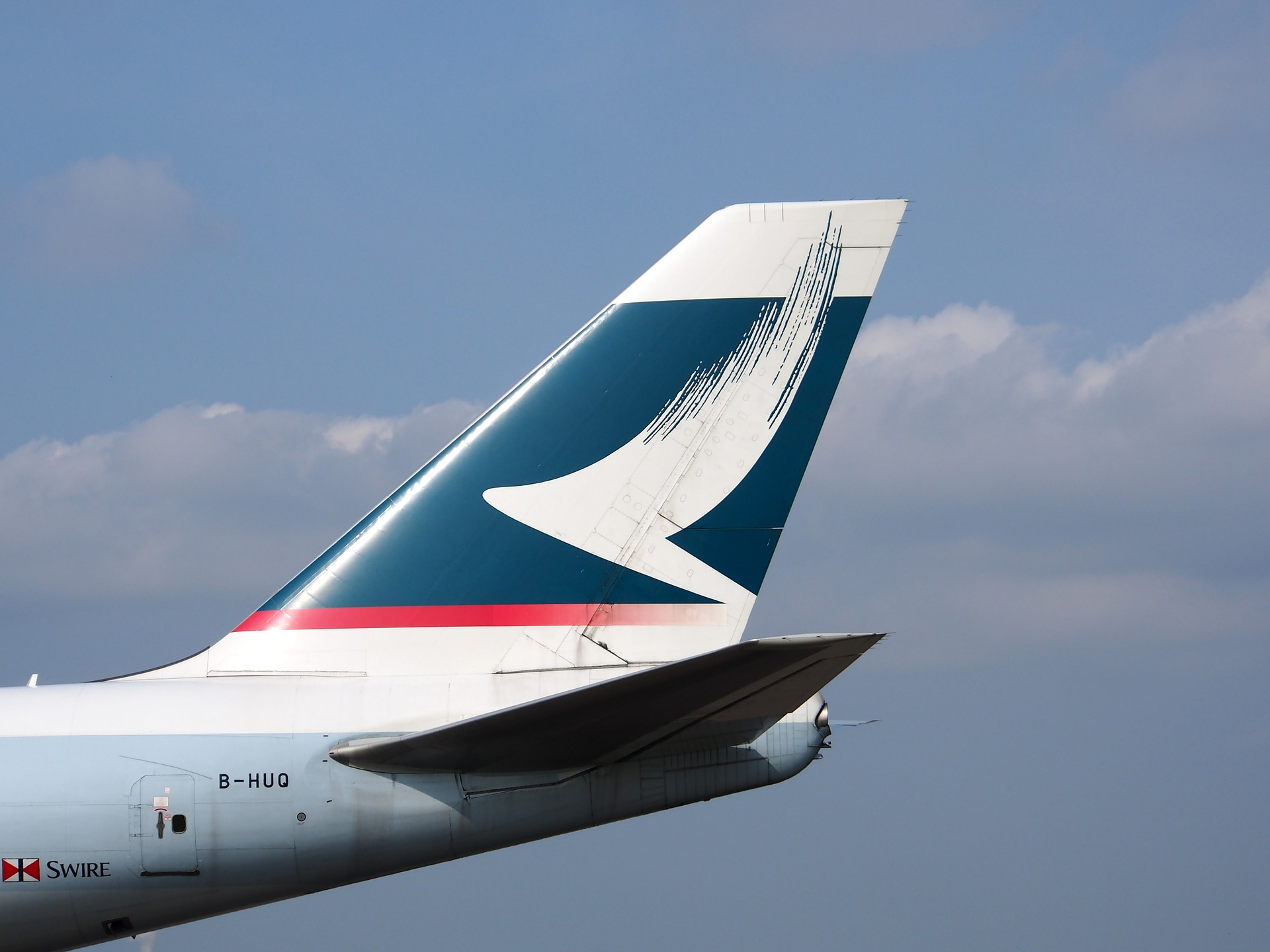 Booking Cathay Pacific with Alaska or American Airlines
