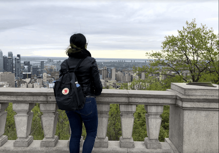 girl looking the city of montreal in canada in the spring