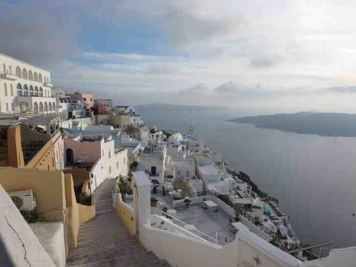 white houses on a cliff in santorini island greece