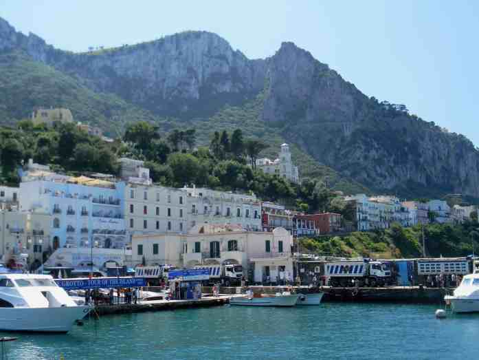 italian landscape of sea and mountain an blue water and boats