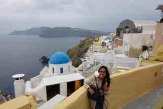 girl with brown coat in Santorini Greece
