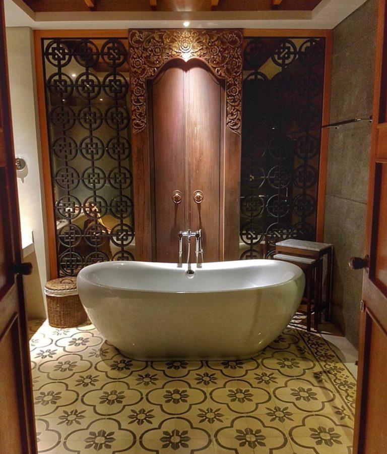 Bathroom and bathtub at Haven Suites Canggu