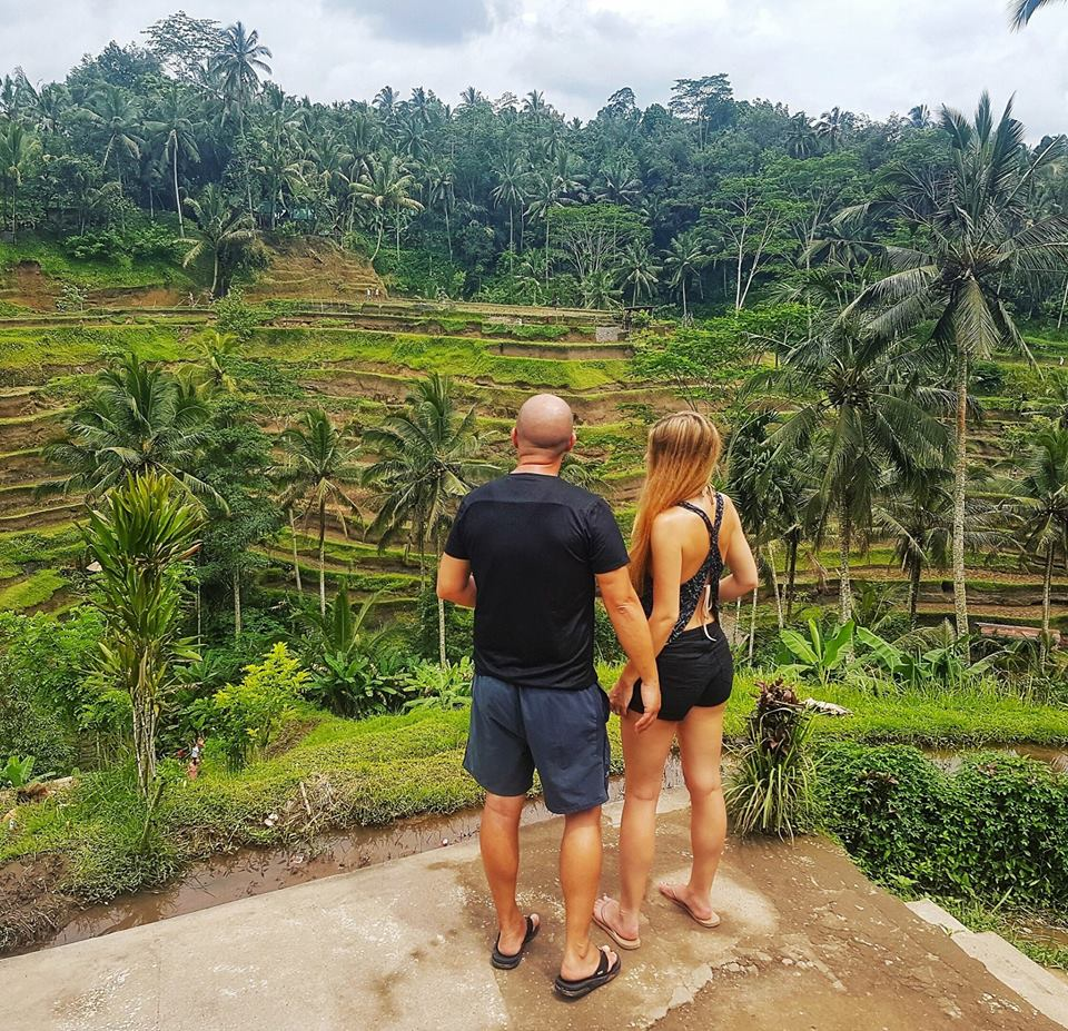 couple on tour in bali by rice fields