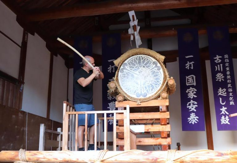 Trevor Kucheran banging the drum in Hida Japan