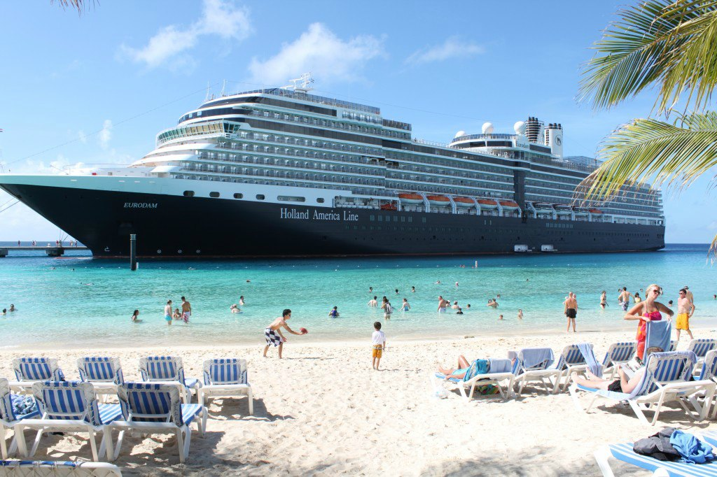 holland america cruise ship at tropical beach