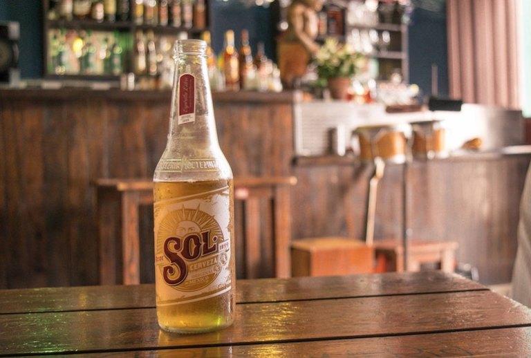 sol beer at beach in havana