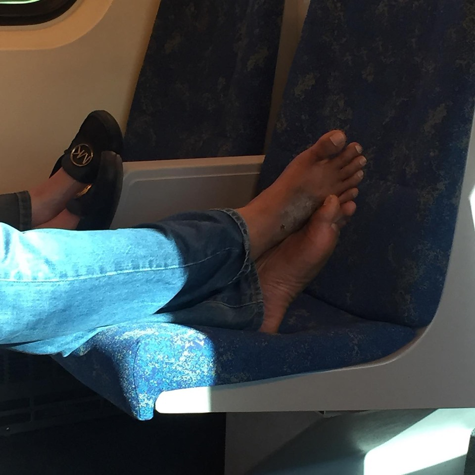 Go train Rider puts feet on seat