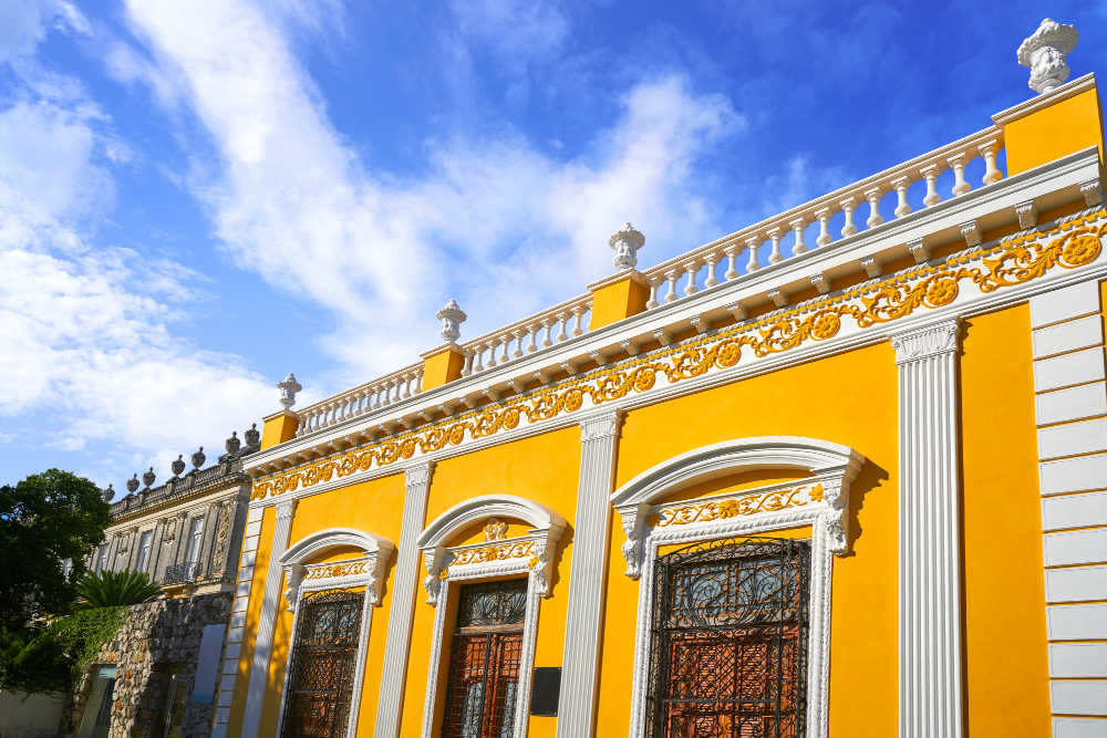 Merida yellow facade in Paseo Montejo of Yucatan in Mexico