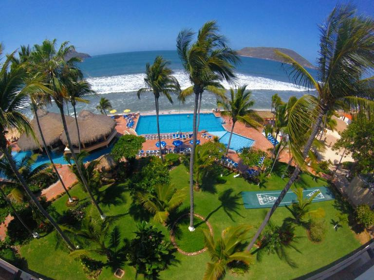 view of the beach and pool at the Palms Resort