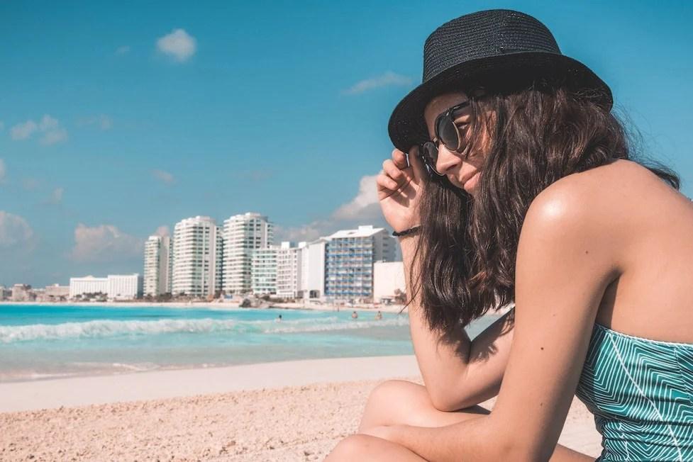 tourist on beach after flight to cancun