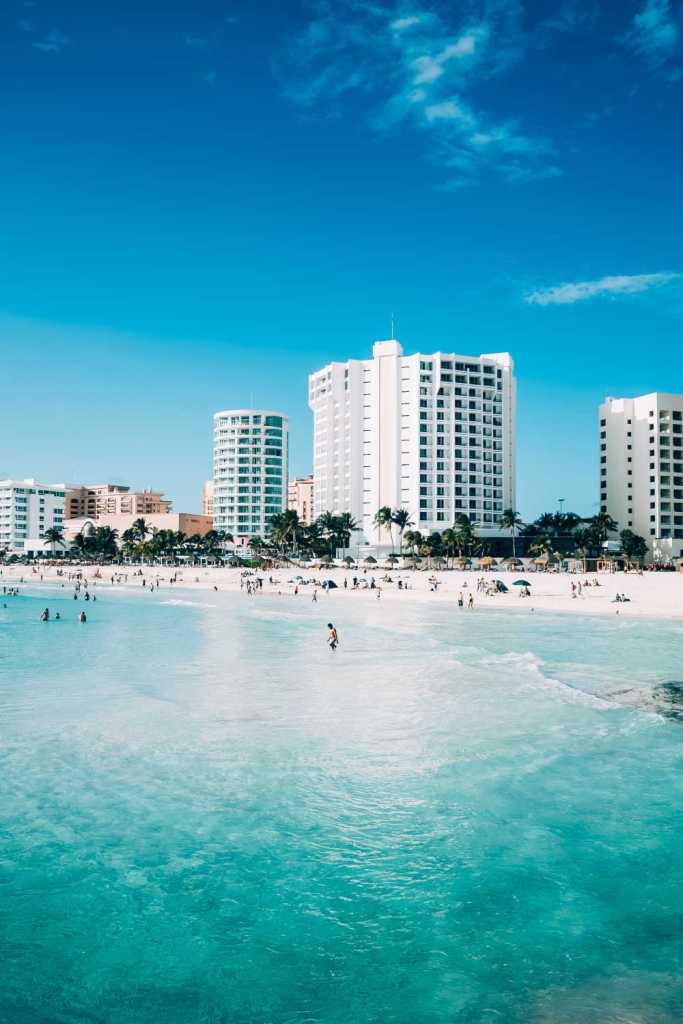 cancun ocean front hotel on white sand beach