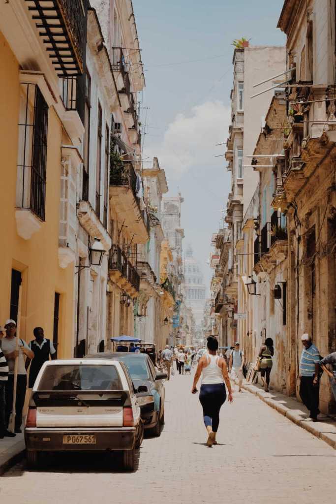 tourists walking streets of havana